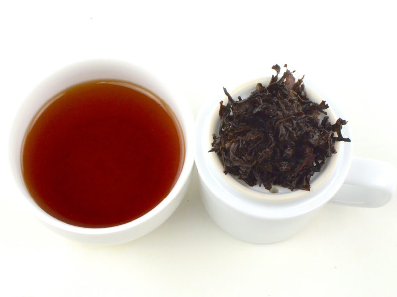 Cupped infusion of Home Store shu puer tea and strained leaves.