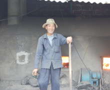 Worker for final stage in processing, controls the fires to completly finish drying all white teas