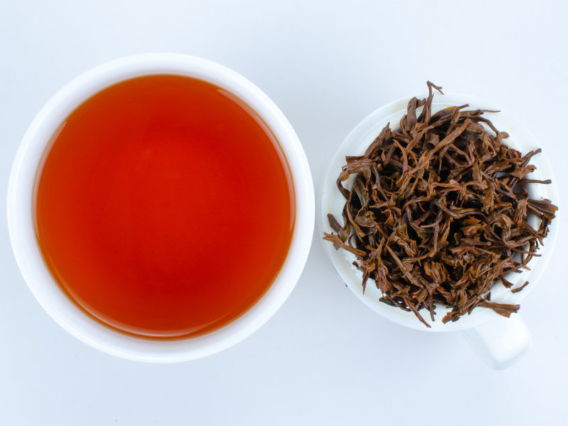 Cupped infusion of Qimen Caixia tea and strained leaves.