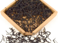 Yu Lan Xiang (Magnolia) Dan Cong wulong tea dry leaves in a wooden display box.