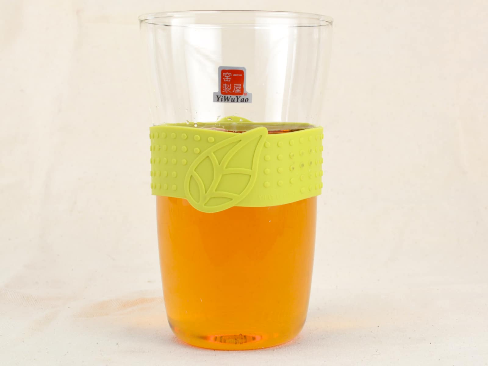 Glass cup with green holder