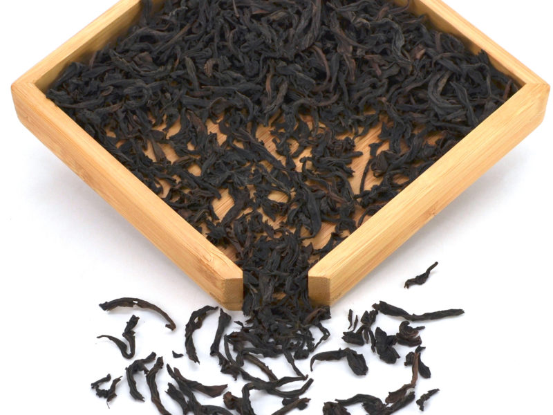 Da Hong Pao (Big Red Robe) rock wulong tea dry leaves in a wooden display box.