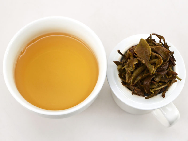 Yue Guang Bai (White Moonlight) white sheng puer tea and strained leaves.