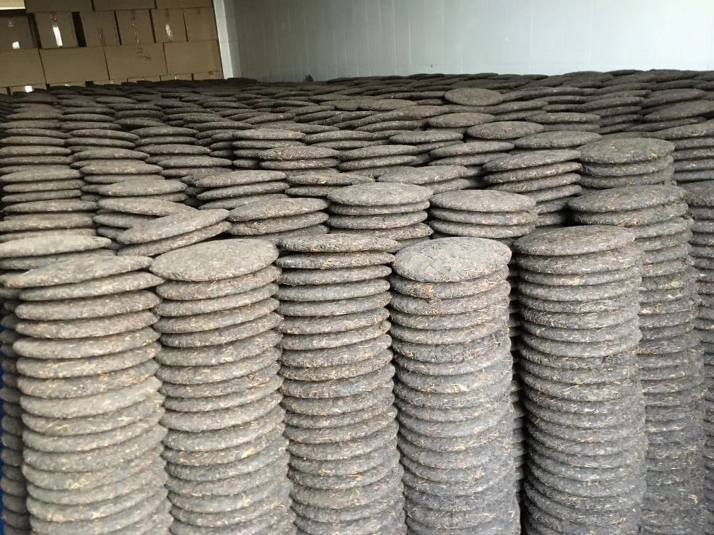 Stacks upon stacks of unwrapped shu puer tea cakes in the Jinggu Factory.