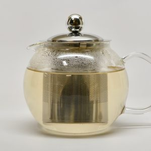 A spherical round glass teapot 600mL fluid capacity and a removable stainless steel filter and lid.