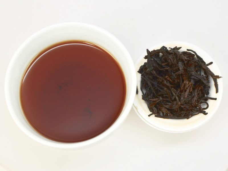 5g of Purple Leaf Shu Puer brewed for 3 minutes with boiling water. The brew is a rich, dark color and the wet leaves are dark and curled.