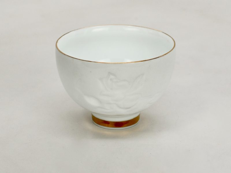 Shadow carved porcelain cup