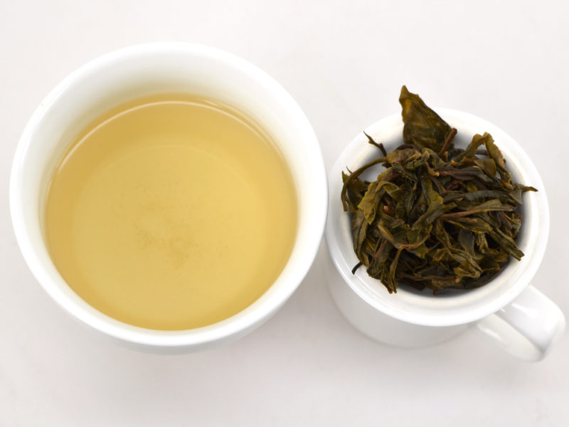 Jinxiu Longzhu (Big Tree Dragon Ball) sheng puer tea and strained leaves.