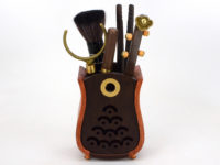 Musical instrument ebony tea utensil set in vase.