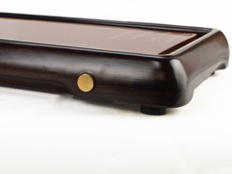 Side view of ebony and rosewood poetry tea tray.