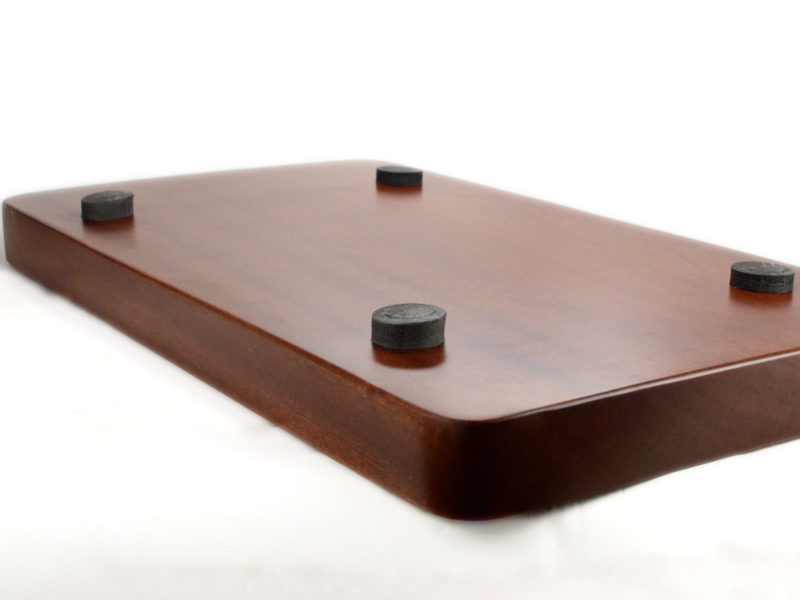 View of cushioned feet on underside of simple solid rosewood tea tray.
