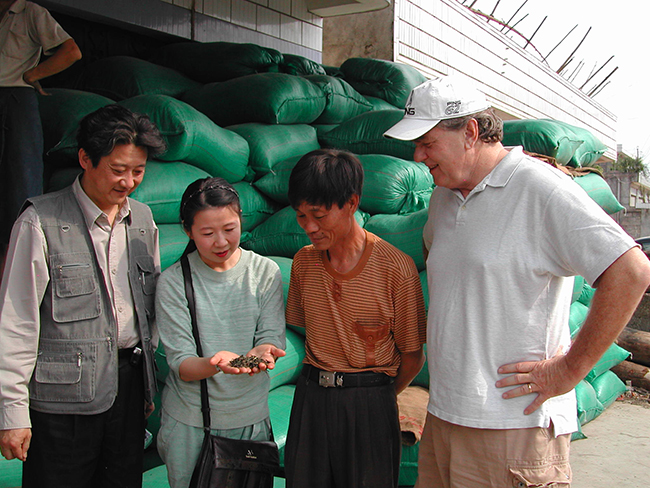 Zhuping and Austin at the Yunnan tea market with puer tea master Hu Haoming in 2005 sourcing puer mao cha